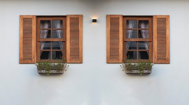 Two modern front windows with white wall from outside view