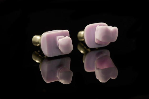 Two molars of lithium disilicate glass-ceramic block for the cad cam technology.