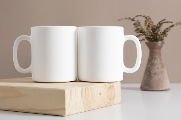 Two mugs mockup on table front view