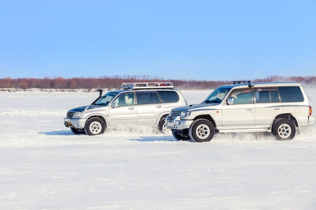 Two off road suvs racing in winter
