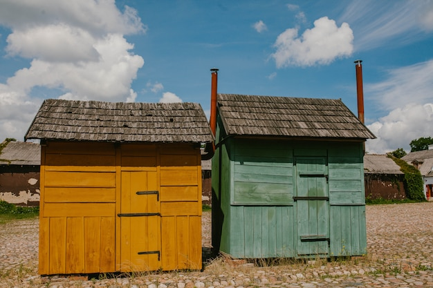 Two old colored shopping kiosks