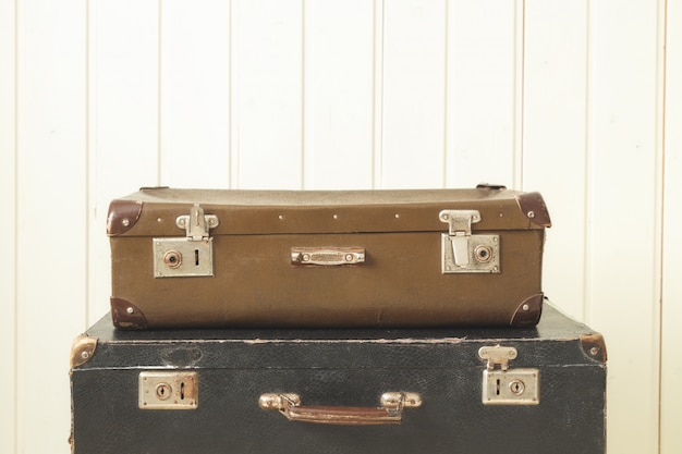 Two old retro suitcases white wood vintage tinting copy space