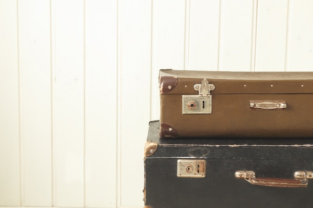 Two old retro suitcases white wood vintage tinting