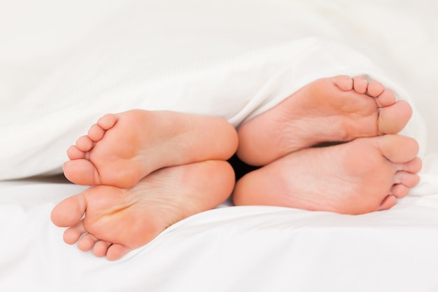 Two pair of feet