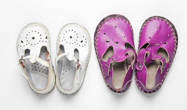 Two pairs of leather childrens sandals on white