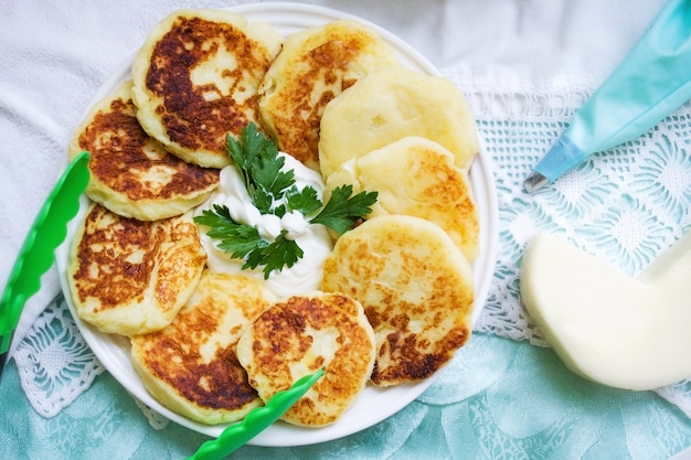 Two pancakes with butter and syrup isolated