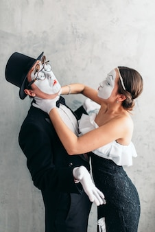 Two pantomime theater artists performing. mime actors with white makeup masks on faces