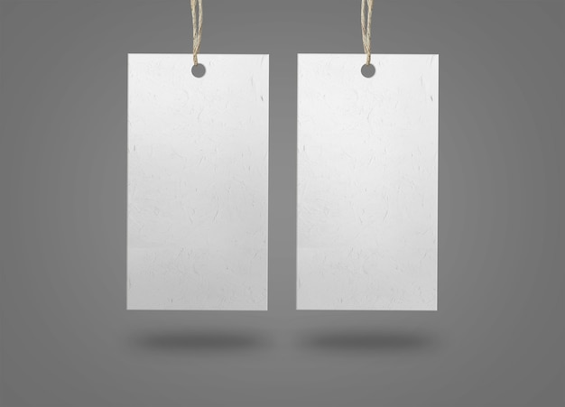 Two paper labels on grey surface