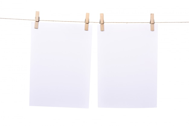 Two paper sheet hanging on rope