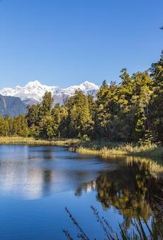 Две вершины, гора кука и гора тасман, южный остров, новая зеландия