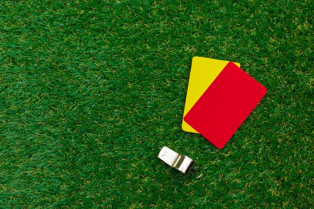 Two penalty cards and a whistle for the referee