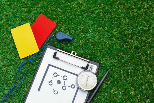 Two penalty cards and a whistle