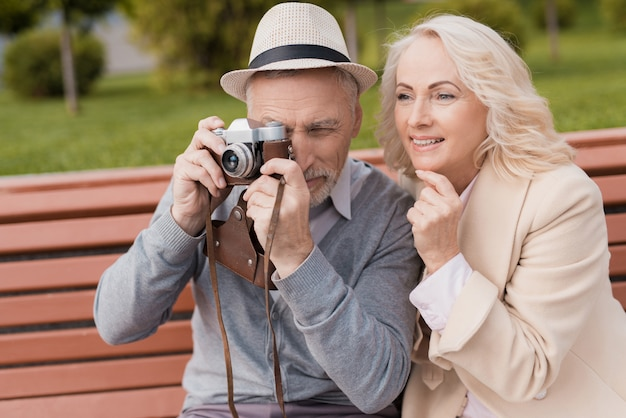 Two pensioners smile and are very happy. Premium Photo