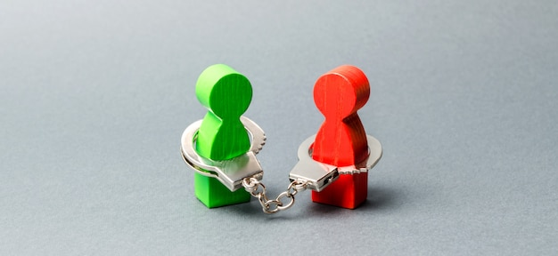 Two people are handcuffed. unbreakable bond. strong trusting relationships and reliable partners.