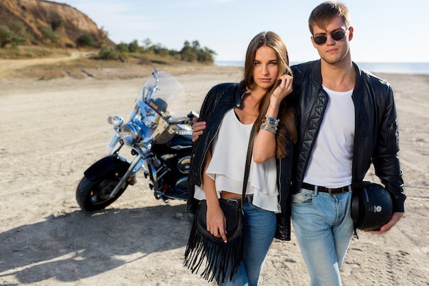 Two people and bike .fashion image of amazing sexy woman and man talk and laughing.