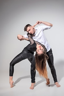 Two people dancing in contemporary style