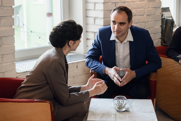 Two people discussing bussiness questions in an informal setting