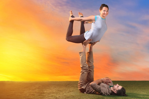 Two people doing yoga exercises