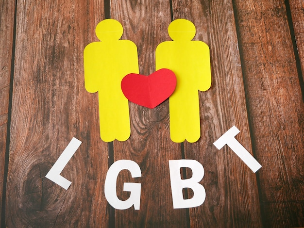 Two people sign with paper heart symbol, lgbt concept