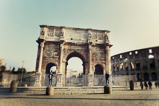 Two people standing on the colums near arch of constantine