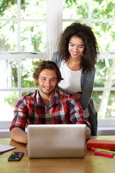 Two people working from home on laptop