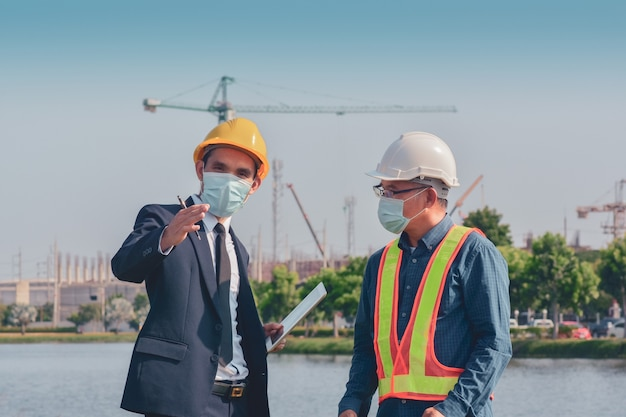 Two people working on site construction and then talking about building project