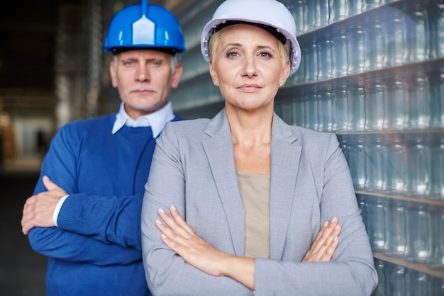 Two people working in warehouse