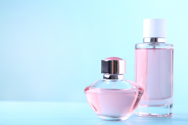 Two perfume bottles on blue