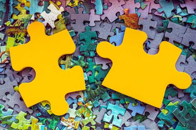 Two pieces of jigsaw puzzle. board gamess. business concept.