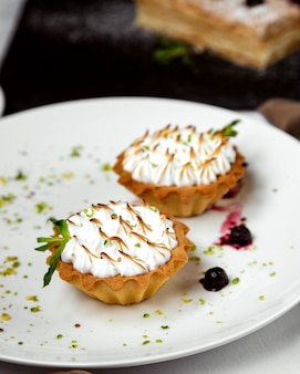 Two pieces of tartalete with burned meringue