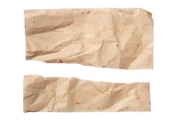 Two pieces of torn paper isolated on white