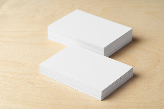 Two piles of blank business cards on table