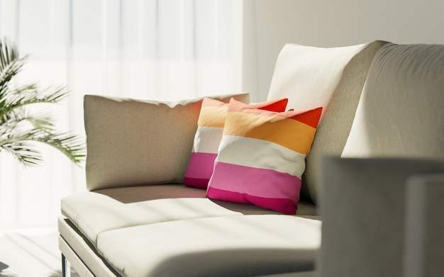 Two pillows painted in the colors of the lesbian flag lie on the couch.
