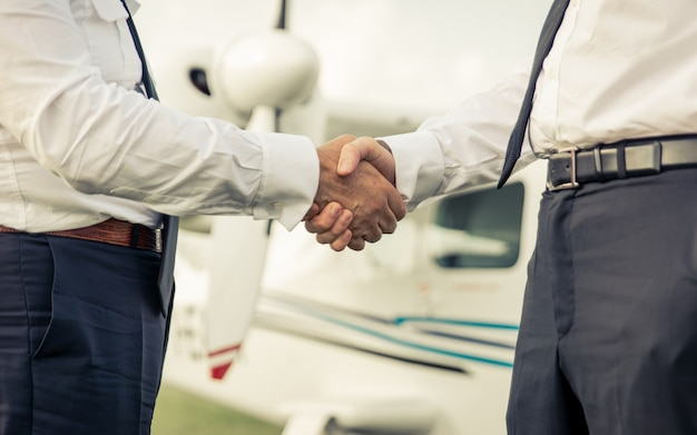 Two pilots shaking hands before flight