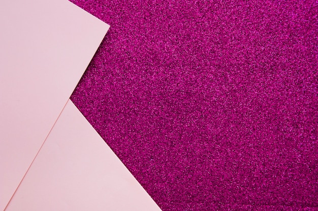 Two pink cardboard papers on purple backdrop