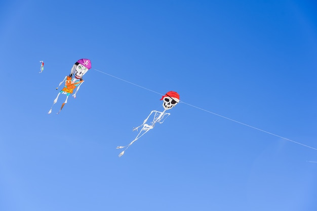 Two pirate skeleton-shaped kites, fun figures to play on hot summer days on the beach.