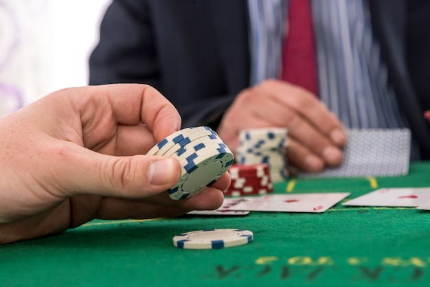 Two players playing poker chips and card or blackjack in casino. gambling concept