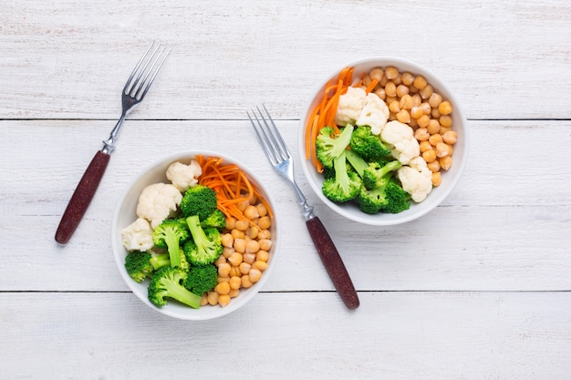 Two poke veggie bowl with chickpeas, broccoli, cauliflower and carrots