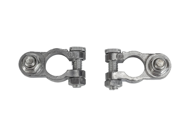 Two positive and negative metal terminal connector of car battery isolated on white background