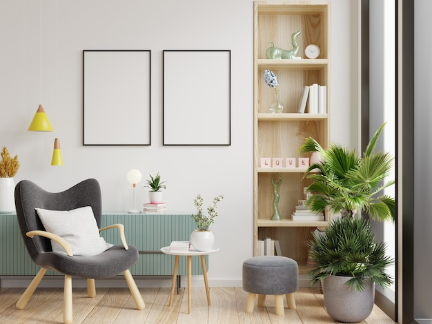 Two poster mockup with vertical frames on empty white wall in living room interior and armchair.3d rendering