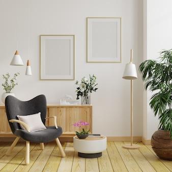 거실 내부 및 안락의자.3d 렌더링의 빈 흰색 벽에 수직 프레임이 있는 두 개의 포스터 모형