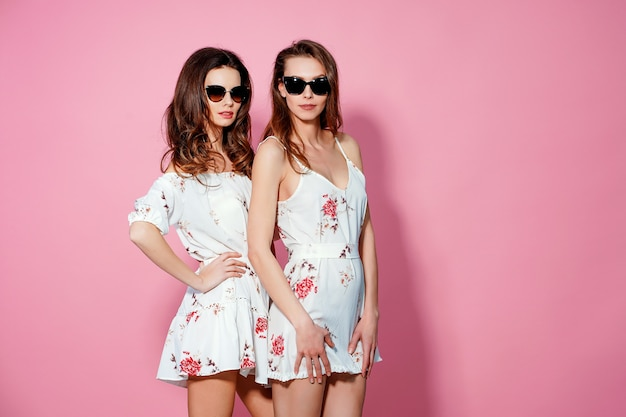 Two pretty friends in summer sundresses