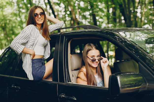 Two pretty girls in a car
