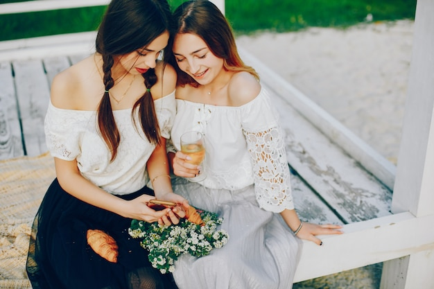 Two pretty girls in a summer park