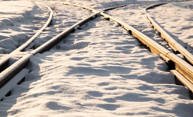 Two railway tracks merge