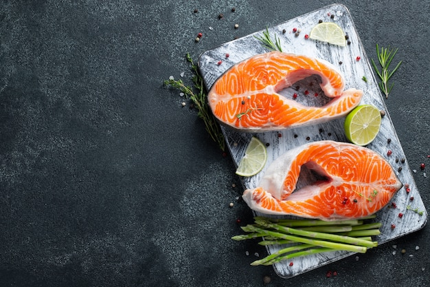 Two raw fresh salmon or trout steaks.