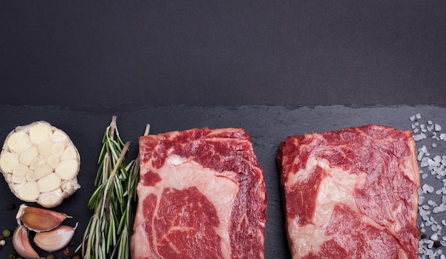 Two raw marble meat, black angus ribeye steak.