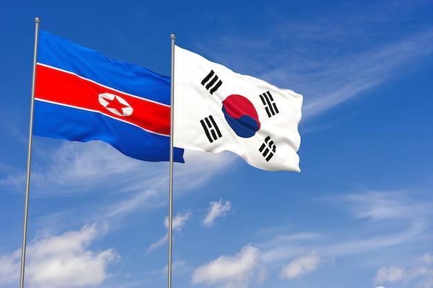 韓国と北朝鮮の2つの現実的な手を振る国旗。青い空の背景に手を振っています。 3dイラスト