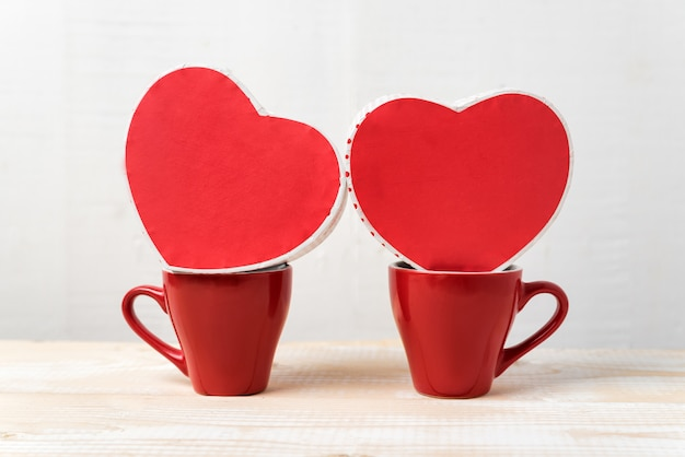 Two red cups and heart shaped boxes. date, valentine's day.