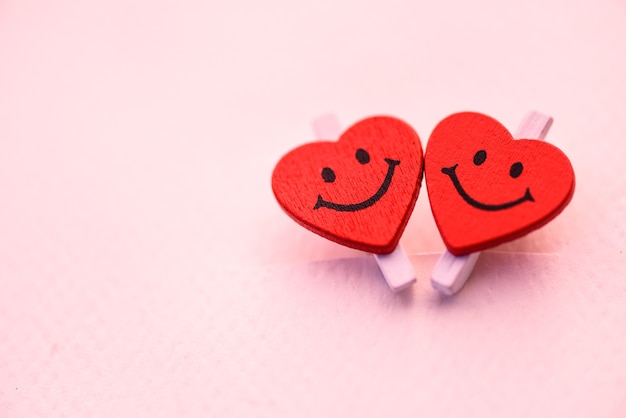 Two red heart with smile emotion. love and valentines day concept.